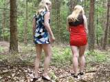 Two students piss in the woods