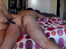 Playing with a toy on his ass